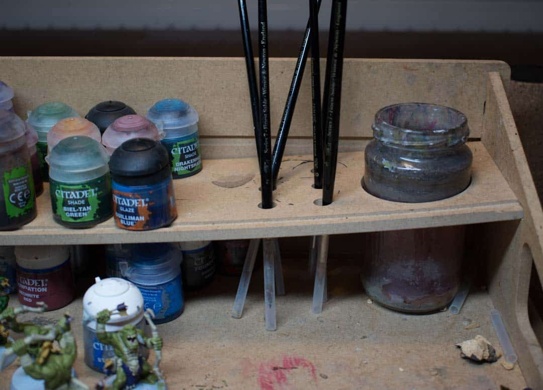 Miniature brushes standing with bristles downwards