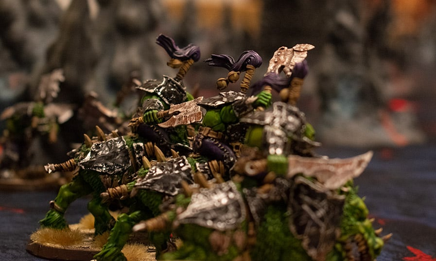 A picture of my Gore Gruntas in the Ironjawz faction painted with rusty and scraped black armour